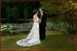 Wedding couple outdoors by lake